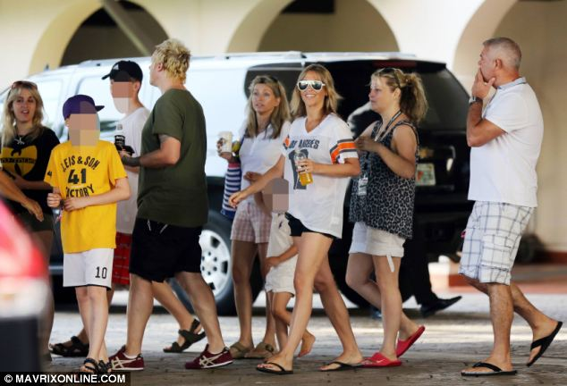 Nicole Appleton, wearing an American Football shirt, shorts and sunglasses, looked happy and relaxed with her family, despite the absence of her wedding ring