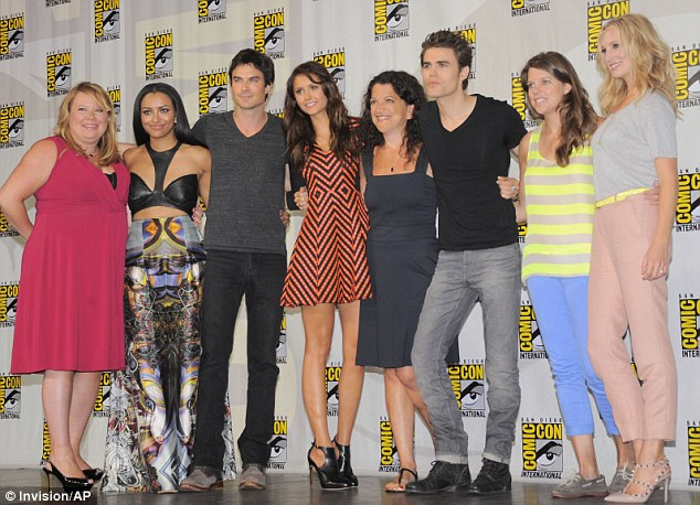 Still good friends: The pair stood next to each other during a group shot as part of the photocall