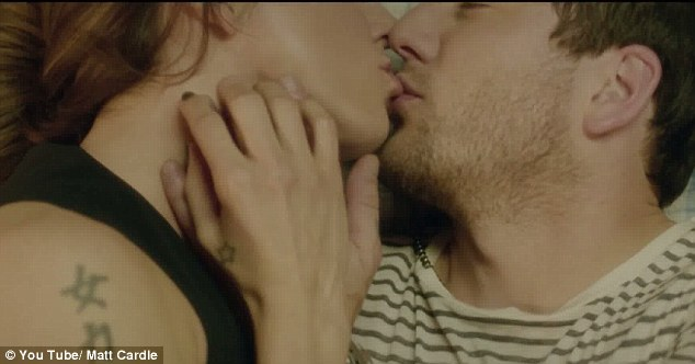 Passion: The pair share a lingering kiss in the music video