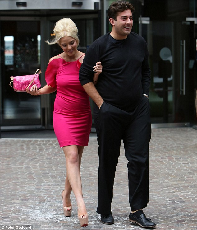 Hold steady: Helen held on to Arg as she negotiated walking in her very high heels