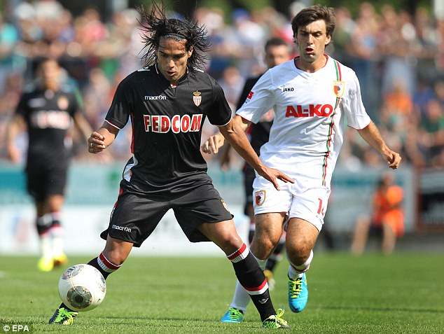 Turning out for a new side: Radamel Falcao vies for the ball with Augsburg's Jan Moravek