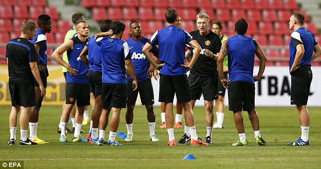 My team: Moyes talks to his Manchester United players