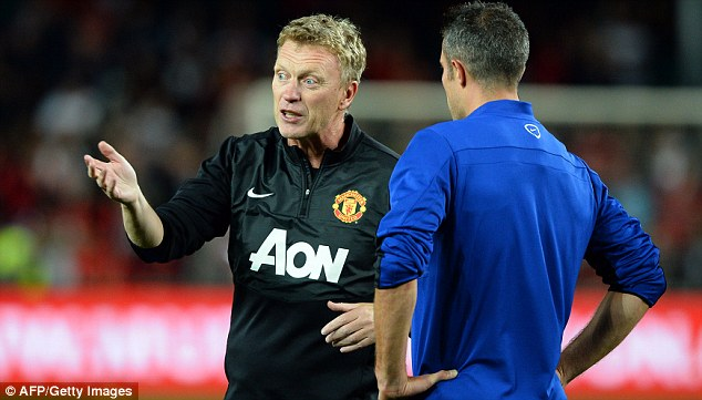 A new era: David Moyes gives instruction to star striker Robin van Persie