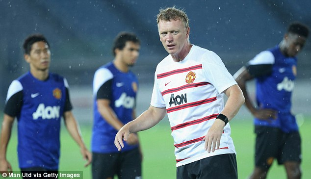 Man in charge: Moyes put his player through their paces in Japan