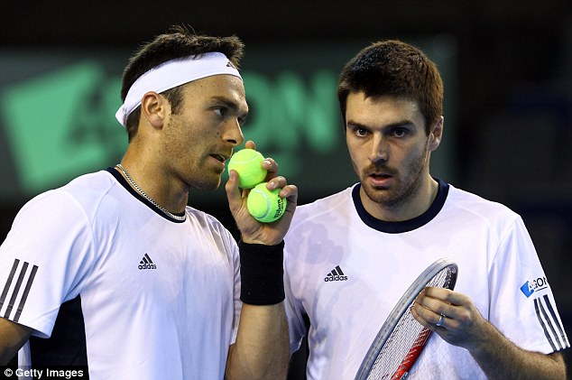 Partners on court: Hutchins hopes to resume his partnership with Fleming in time for the Australian Open