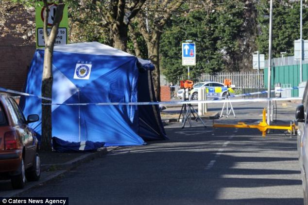 Investigation: A police forensic tent stands at the scene of Mr Saleem's murder in Small Heath, Birmingham