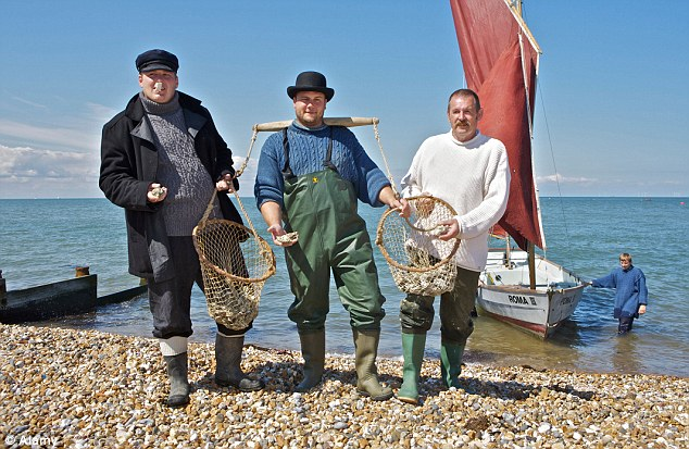 Harvest festival: A group of fisherman show-off their oyster haul in Whitstable, Kent