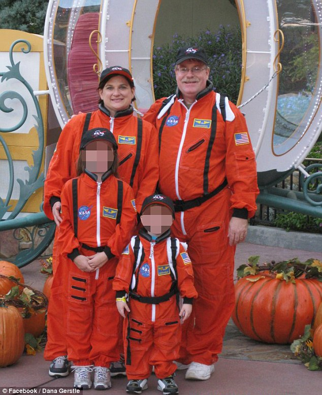 Saved by Zimmerman: The Gerstle family of Dana (left) and Mark (right) stand with their children in a October 2011 photo snapped at a Disney World Halloween party