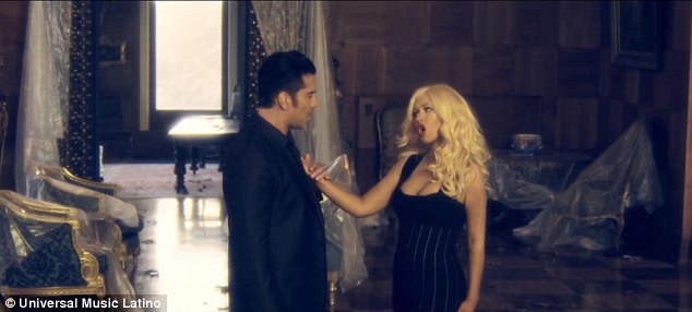 Joining together: Alejandro and Christina are then seen singing to each other as they stand in an abandoned mansion
