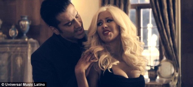 Feeling the chemistry: Christina jutted out her bust as she leaned seductively against Alejandro