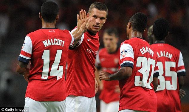 Positive: Lukas Podolski would be pleased to see Arsenal sign Suarez