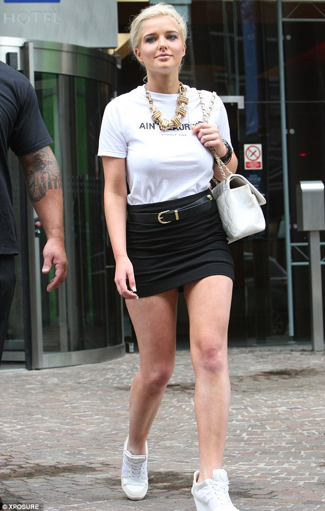 Bashful: Helen Flanagan steps out looking rather coy just a few hours after falling over in her heels while out the night before