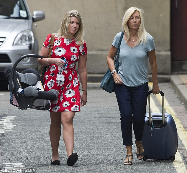 The car seat arrives at the Lindo Wing earlier today carried by an aide, left, who accompanied Kate and William's hair stylist Amanda Cook Tucker, right