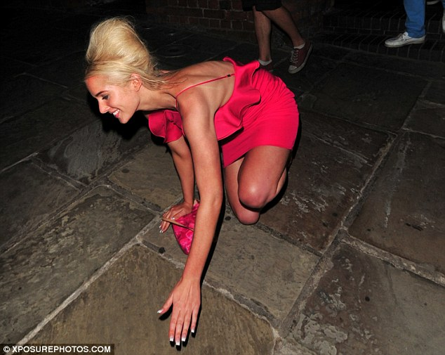 Going, going, gone: Helen still had a big grin on her face as she tumbled to the floor dramatically