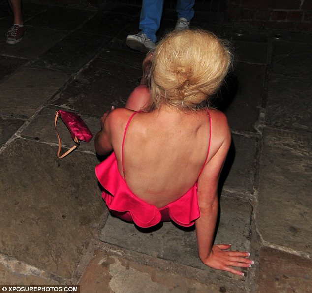Letting go: Helen had leg go of her Louis Vuitton hangbag as she tumbled to the ground