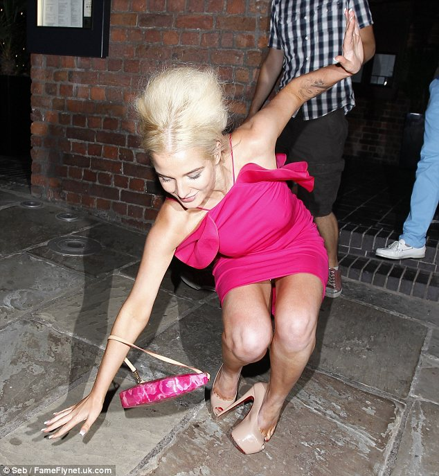Head over heels: Helen Falanagan ended up falling over after loosing her footing in a pair of super high heels