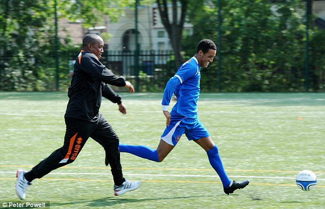 Catch me if you can: Tom Ince is chased down by Blackpool manager and father Paul Ince