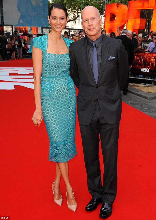 Back on her home turf: English model Emma Willis joins her husband Bruce at the UK premiere of Red 2 in London