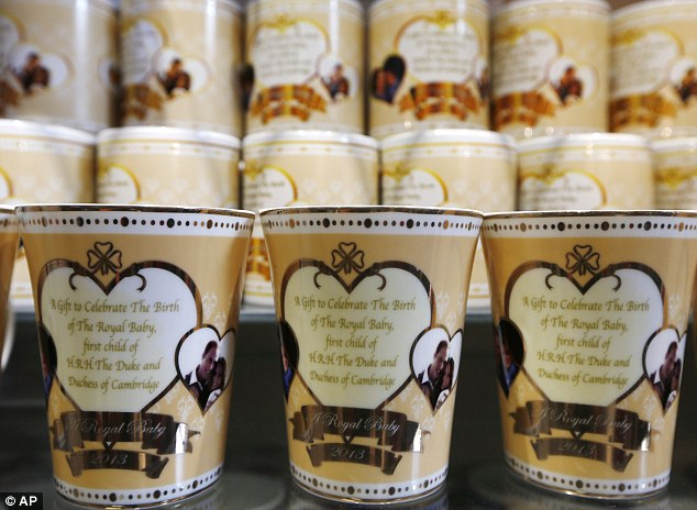 Royal souvenirs: Cups to mark the birth of the royal baby which had gone on sale in central London almost two weeks in advance of the birth