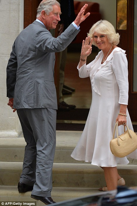 Prince Charles and his wife Camilla walk up the steps