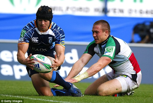 Blues boy: Halfpenny beats England star Mike Brown to score for Cardiff in the Heineken Cup
