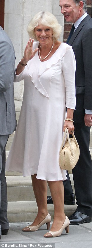 All white: Camilla in the elegant silk dress she wore earlier for her public engagement in Yorkshire