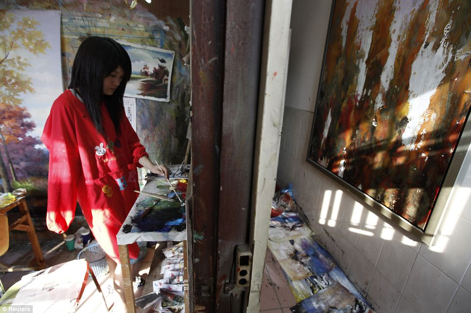A painter, who has lost a right arm, works in her studio