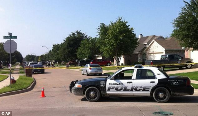 Scene: Five officers arrived at the home in Saginaw, Texas and allegedly watched as Holder pulled out a gun from his wasitband. He is said to have shot one officer, hitting him in the groin, before he was shot in the head
