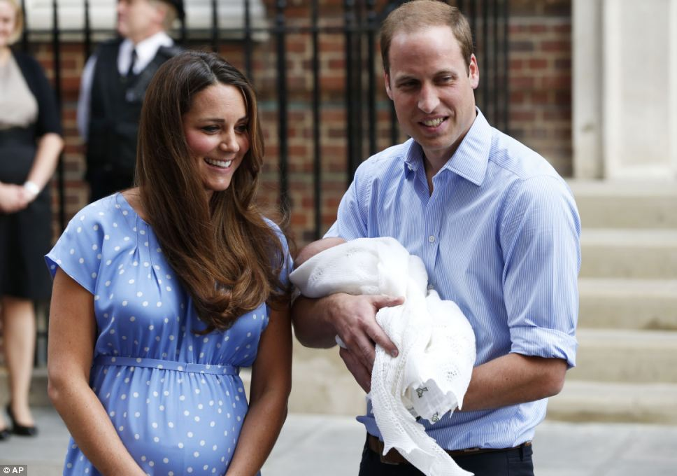Comfortable: Prince William held his newborn son with confidence outside the maternity wing of the hospital this evening