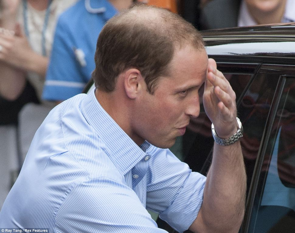 Passed with flying colours: Prince William wipes sweat from his brow as he leaves the hospital in London tonight