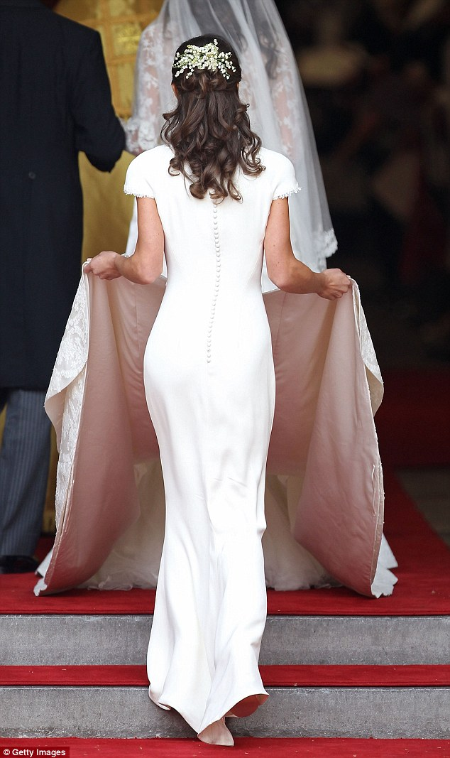 Historic: Pippa Middleton is pictured carrying out her duties at the wedding of the Duke and Duchess of Cambridge
