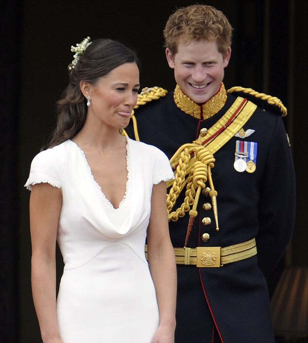 Beaming: Prince Harry and Pippa Middleton on the balcony of Buckingham Palace following the wedding of the Duke and Duchess of Cambridge