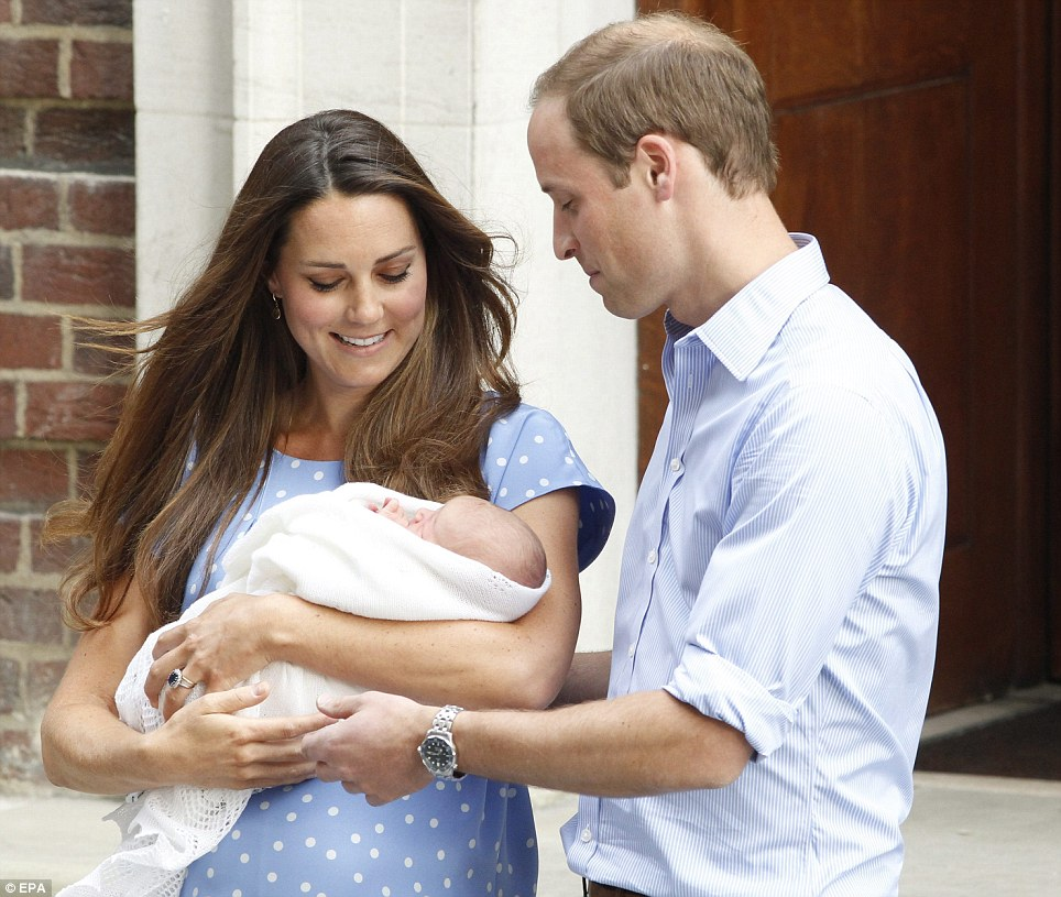 Let me have a go: William tentatively reaches for the baby