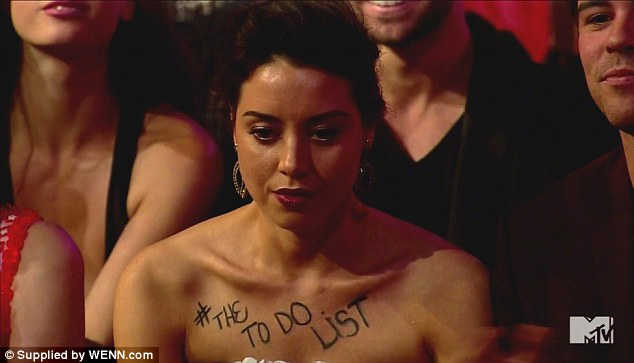 Ready to rumble: An apparently inebriated Aubrey did a little self-promotion at the MTV Movie Awards in April, scrawling her movie's title across her chest