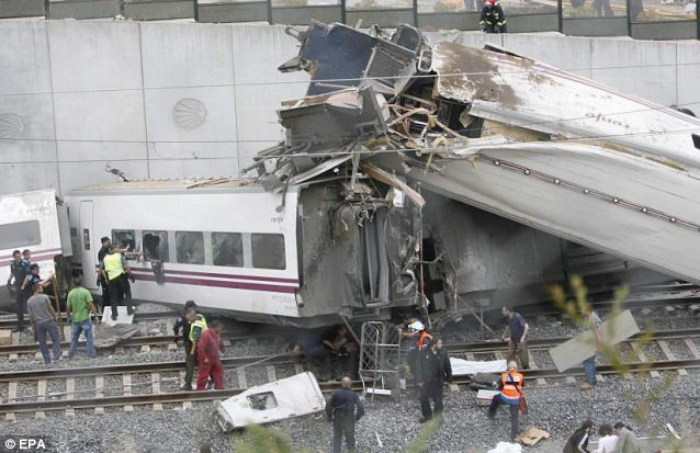 Tragic: Emergency crews work to help those who were injured in the Spanish train crash which happened just outside Santiago de Compostela