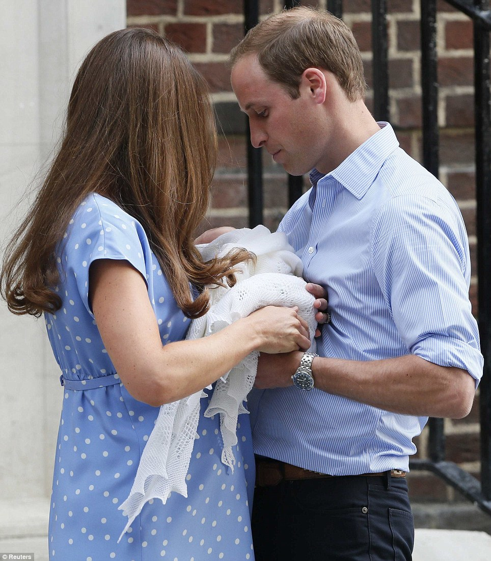 Let the handover begin: Kate leans in, but keeps a firm hold