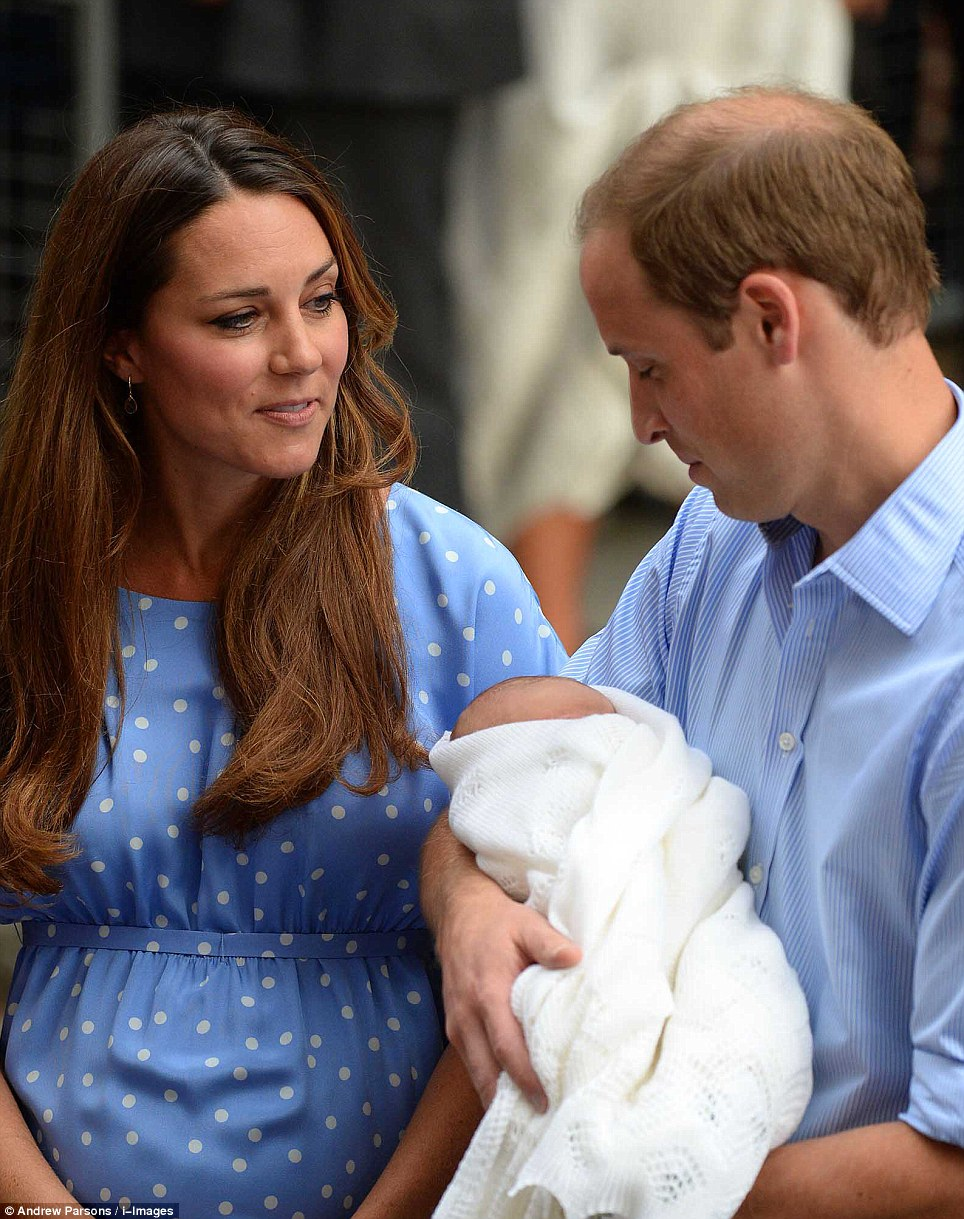 Family unit: The Duchess looks on as William concentrates