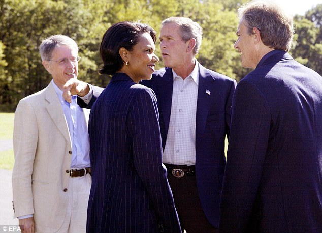 Key figure: Sir David is pictured with Tony Blair, President George W Bush and then security adviser Condoleezza Rice on a visit to the US in 2002