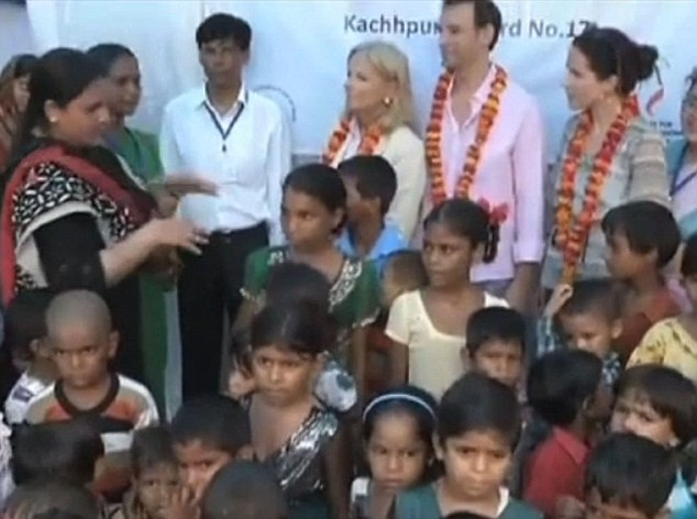 Special visit: Jill Biden visits a slum in Agra, India with her daughter and son-in-law during the Vice President's four-day visit