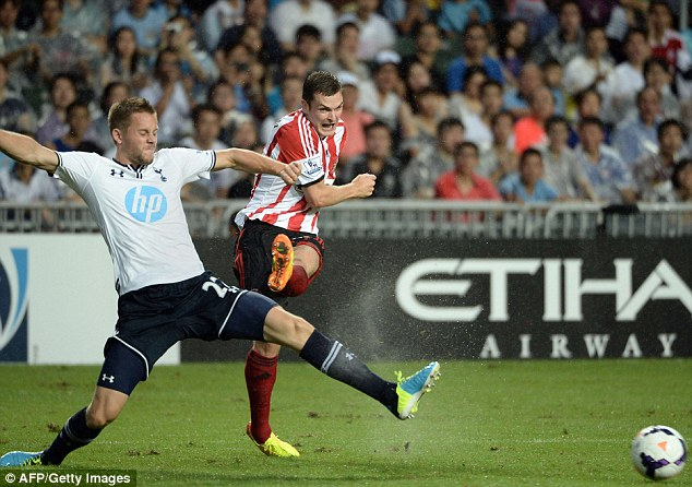 In action: Gylfi Siguardsson (left) challenges Adam Johnson as they battle for the ball