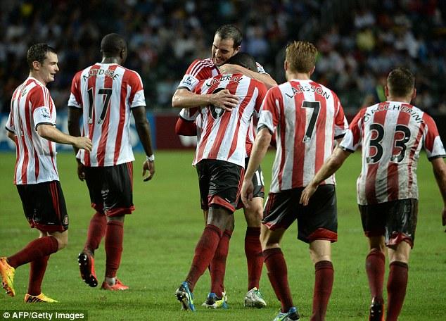 Celebration: Sunderland captain shows new boy Cabral some love after his equalising goal