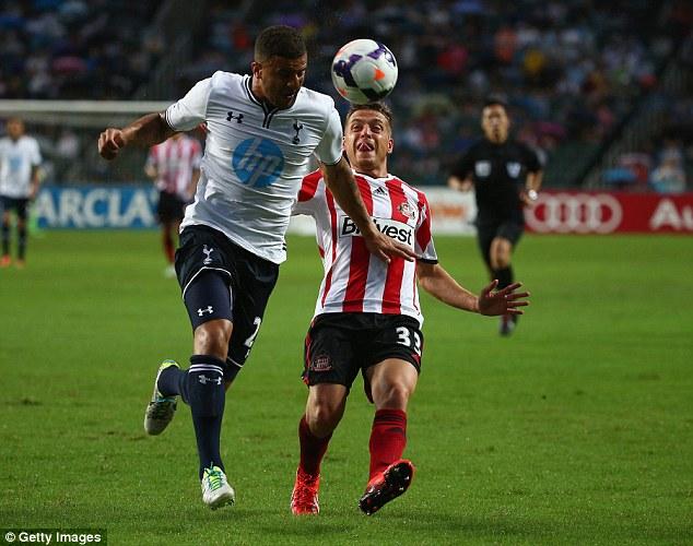 Battle: Kyle Walker  (left) heads the ball away from Emanuele Giaccherini