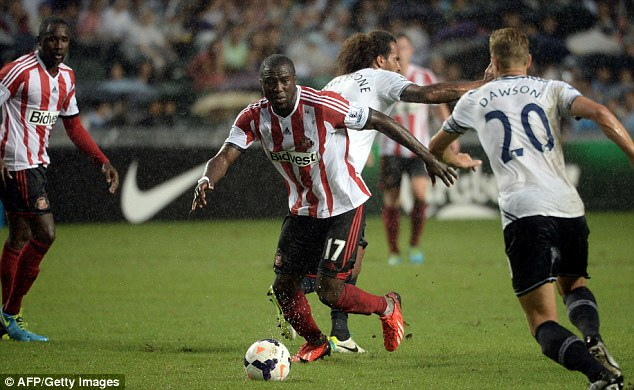 In action: Jozy Altidore takes the ball through the driving rain with Michael Dawson closing down