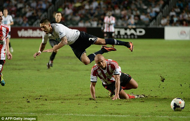 Flying: Clint Dempsey feels the full force of a challenge from Sunderland's Wes Brown