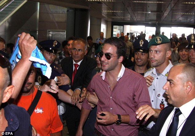Rock star welcome: Higuain is mobbed at the airport