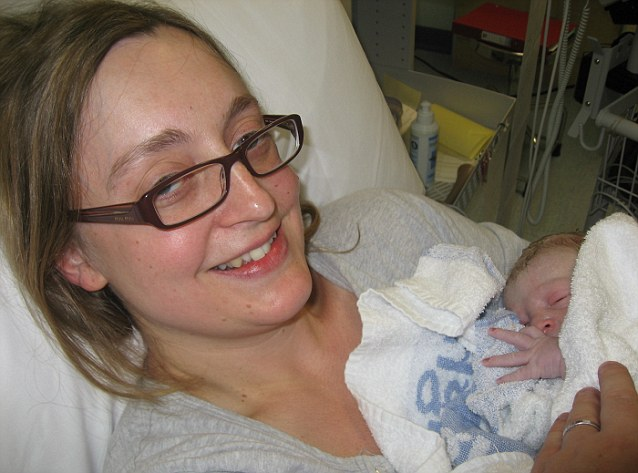 Anna White with her baby Rory, her second child, a few minutes after he was born on 11 November 2011