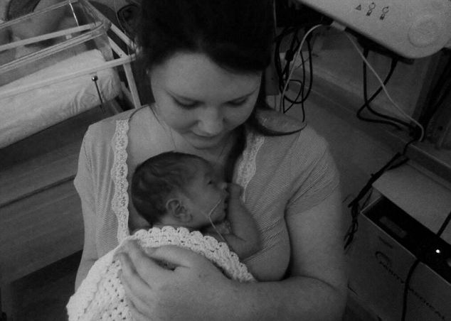 Roisin McDougall pictured with her son in the Special Care Baby Unit