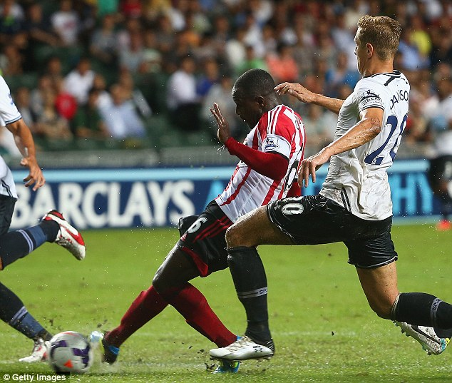 Classy strike: Sunderland's Cabral aims the ball past Friedel for the Mackems' first goal before celebrating (below)
