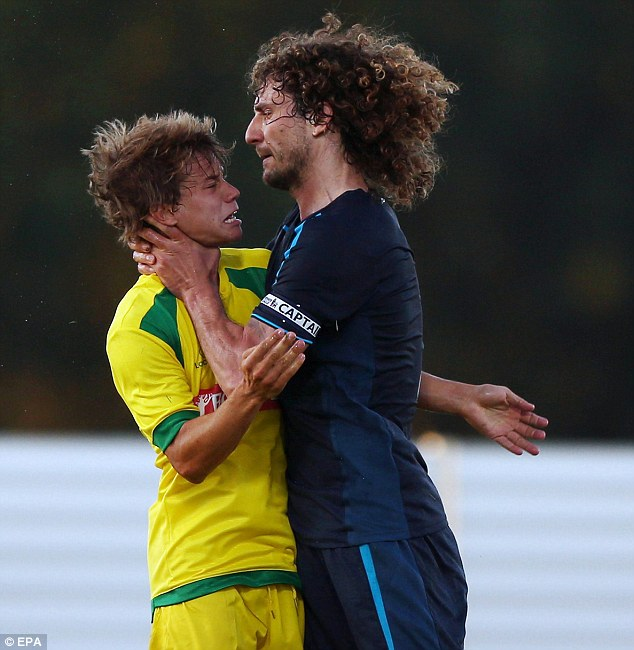 Have that! Fabricio Coloccini clashed with Pacos Ferreira striker Caetano in a friendly
