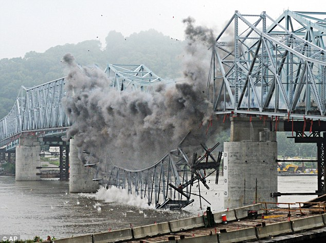 Using many small explosive charges placed at critical locations on the bridge, the charges were detonated in intervals to control the direction of fall